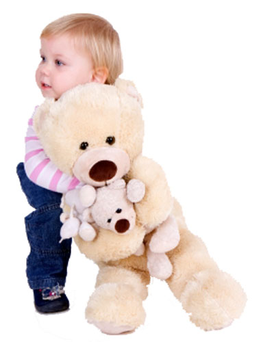 Toddler with teddy bears